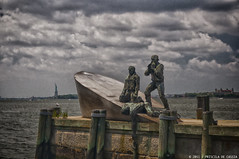 The American Merchant Mariners' Memorial (Priscila de Cssia) Tags: nyc travel usa newyork monument statue america landscape nikon memorial cityscape grain dramatic batterypark grainy drama hdr nikond90