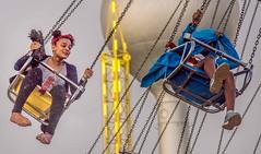 Then Came The Rain (Wes Iversen) Tags: people water rain chains fairs michigan swings swing watertowers carnivals carnivalrides davisburg oaklandcountyfair nikkor18300mm