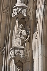 Barcelona. Cathedral church of the Holy Cross and Saint Eulalia. Neo-Gothic facade. Musician angel. Archivolt figure. 1887-1890. Joan Roig i Sol, sculptor (Catalan Art & Architecture Gallery (Josep Bracons)) Tags: barcelona musician sculpture music art church angel gallery arte cathedral kunst ange joan catedral iglesia kirche skulptur catalonia escultura chiesa seu igreja catalunya duomo sole prophet eglise 1890 catalua catalan barcelone cathedrale seo soler catala prophete profeta katalonien josep catalogne esglesia 1887 roig musico catedrale voussoir archivolt bracons barrio arquivolta barri gotic archivolte gotico