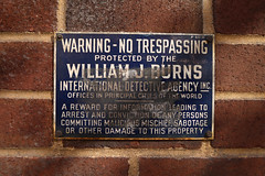 Protected by the William J. Burns (jschumacher) Tags: nyc sign williamjburnsinternationaldetectiveagency