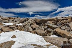 Snow Fields and Swirls (kevin-palmer) Tags: cloudpeakwilderness bighornmountains bighornnationalforest wyoming summer july nikond750 tamron2470mmf28 alpine cloudpeak snow snowfield blue sky clouds circularpolarizer boulders swirls