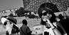 Sun protection. (Baz 120) Tags: candid candidstreet candidportrait city candidface candidphotography contrast street streetphoto streetcandid streetphotography streetphotograph streetportrait streetfaces monochrome monotone mono blackandwhite bw urban noiretblanc voigtlandercolorskopar21mmf40 life leicam8 leica primelens portrait people unposed italy italia girl grittystreetphotography flashstreetphotography faces flash rome roma romepeople romecandid romestreets decisivemoment strangers