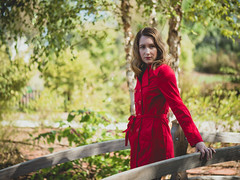 Red coat (Vincent F Tsai) Tags: fashion portrait girl model pose bridge fall autumn coat trench red trees shade blonde stare light backlit panasonic lumixg7 leicadgnocticron425mmf12
