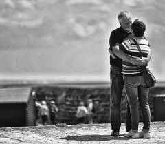 Young Love (mnika4) Tags: shadow sky people blackandwhite white black cute love wall contrast person blackwhite hug kiss couple candid streetphotography documentary structure cobb embrace lymeregis desaturate