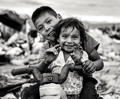 I choose love. (elweydelasfotos) Tags: kids love black white bnw nikon d810 smile portrait retrato happy happiness children future street playing play toys best amazing flickrtravelaward