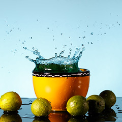 Lime Splashes (Ian Nishi Roberts) Tags: blue water yellow flash bowl lime splash waterdrops liquid highspeed