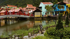 1T9A2411 (Victor Mitri) Tags: wooden woodenbridge river lake reflection town colors brdige mountains clouds raining buildings red beautiful urbain malaysia langkawi green trees