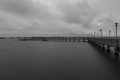 Afternoon on black and white. (Pablin79) Tags: longexposure bridge light sky white black argentina monochrome rain clouds pier afternoon shadows outdoor misiones posadas