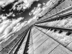 Riding the rails (Vness Lane) Tags: concretesky bwclouds blackandwhiteclouds construction railtrain ip iphoto concrete cloudyoverrail skyview bwsky monotone blackandwhite bw monochromic guideway hdr traintracks train choochoo rail