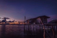 Rise and shine (Syahrel Azha Hashim) Tags: ocean longexposure morning travel light vacation house holiday detail beach nature colors beautiful clouds sunrise island boat nikon colorful asia dof getaway details horizon scenic naturallight nopeople tokina malaysia slowshutter tropical shallow woodenhouse simple fishingboat dramaticsky residential sabah clearsky fishingvillage sandybeach 2016 ultrawideangle colorimage semporna housesonstilts d300s denawanisland syahrel