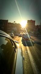 IMG_20150415_133542 (juangaytan) Tags: car sunset lookingback bridge road driving