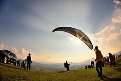 Ready to go.... (Vincent_Ting) Tags:    taiwan clouds light sky seaofclouds blue  sunrise     foggy  sunset  city vincentting gettyimages  paraglider paragliding
