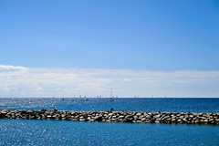 A sunny day to sail (Fnikos) Tags: sun sunny light sky skyline sea water waterfront rock rocks seascape boat sail sailing sailboat vehicle serene outdoor