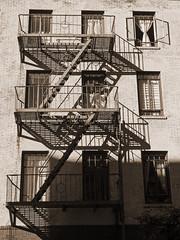 Shadows and curtains (ljewler) Tags: urban shadows newyork sepia fireescape olympus zd