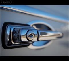 VW Detail 1 (KSGarriott) Tags: door old white detail reflection classic car metal vw handle classiccar shiny mechanical lock antique beetle machine olympus reflect chrome vehicle keyhole volkswagon omd 1240mm ksgarriott scottgarriott em5ii