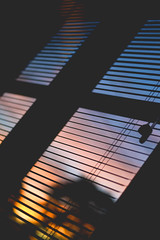 50mm sunset (Kaleigh K) Tags: diagonal 50mm nikon d3100 sunset colorful blur window perspective blinds experimental