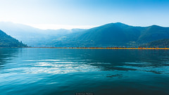 Ants (Nicola Pezzoli) Tags: blue italy lake tourism water colors yellow sunrise canon reflections landscape piers ant floating monte bergamo brescia lombardia isola iseo sulzano