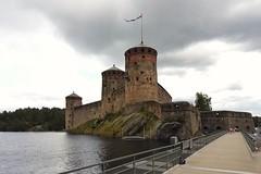 Olavinlinna castle right before thunderstorm (KaarinaT) Tags: pontoonbridge bridge pontoon olavinlinna olavinlinnacastle stronghold fortress water lake thunderstorm blackwater blackclouds darkclouds rightbeforethunderstorm savonlinna finland rockcastle