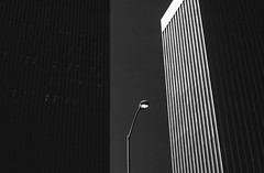 Lamp post between two buildings on a sunny afternoon downtown Seattle Washington State USA (Jim Corwin's PhotoStream) Tags: downtown building lamppost silhouetted design shapes cityscape urbanscene architecture city streetlight nobody outdoors buildingexterior photography contrast lightanddark line lines seattle modern cities officebuilding exterior skyscraper facade horizontal daytime tallbuilding highcontrast