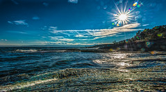 Sunburst (Tore Thiis Fjeld) Tags: sunburst sun sunbeams sunlight sunrays rays sea outdoor seascape nature waves water coastalrocks sky cluds color lensflare panorama ship distant horizon light norway hurum skjttelvik bright colors