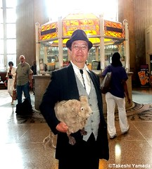 "Dr. Takeshi Yamada and Seara (sea rabbit) at the Newark Penn Station in Newark, New Jersey. Jersey Devil Expedition. Icarosaurus Expedition.  20140725 100_3422===C. ""Summer 2014 is coldest in a decade on New York"" (Ref. NY Post). (searabbits23) Tags: ny newyork sexy celebrity art hat fashion animal brooklyn painting asian coneyisland japanese star tv google king artist dragon god cosplay manhattan wildlife famous gothic goth performance pop taxidermy vogue cnn tuxedo bikini tophat unitednations playboy entertainer takeshi samurai genius mermaid amc johnnydepp mardigras salvadordali unicorn billclinton billgates aol vangogh curiosities sideshow jeffkoons globalwarming takashimurakami pablopicasso steampunk yamada damienhirst cryptozoology freakshow barackobama seara immortalized takeshiyamada museumofworldwonders roguetaxidermy searabbit ladygaga climategate minnesotaassociationofroguetaxidermists"