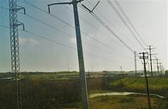 (Photosintheattic) Tags: cable pylon powerline outdoor creek pond water sky clouds flickr land grass wires bush brush shadows rv tank train trees landscape