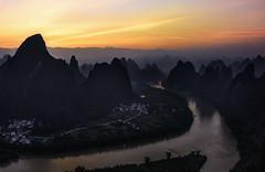 The first sun at Xiangtangshan (Massetti Fabrizio) Tags: guilin cina china cambo rodenstock rural river xiangtangshan yangshuo yangshou red li liriver guangxi