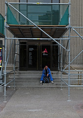 Under The Scaffold (Sherlock77 (James)) Tags: calgary downtown streetphotography people man building scaffold
