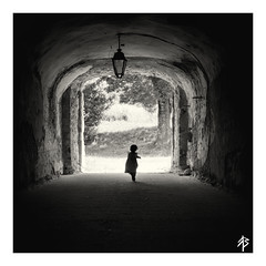 From darkness into light... (fearghal breathnach) Tags: fromdarknessintolight child childphotography running shadows light squareformat candid border portrait blackwhite bw monochrome tunnel dark darkness run silhouette