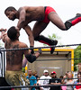 From the top rope.  Wrestling exhibition at the Cinco de Mayo celebration on Cherokee Street in St Louis, Missouri. (Matt Wicks / GreatDistances) Tags: shirtless usa man men jump nikon holidays muscular wrestling attack stlouis missouri northamerica wrestler fighting spectators wrestlers cincodemayo toprope 2015 d610 wrestlingring