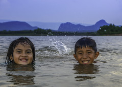 Twins Smile (narenrit) Tags: summer lake mountains smile asia tropical waters wimming