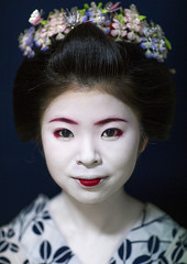 Portrait of a 16 years old maiko called chikasaya, Kansai region, Kyoto, Japan (Eric Lafforgue) Tags: portrait woman white beautiful beauty face japan vertical closeup female hair asian japanese clothing eyes kyoto colorful asia pretty feminine painted young culture makeup front grace indoors teen maiko geisha teenager kimono gion tradition oriental youngadult solitary hairstyle youngwoman apprentice oneperson headwear elaborate kanzashi darkbackground lookingatcamera 1617years oneyoungwomanonly 1people japaneseethnicity colourpicture chikasaya komayaokiya japan161937