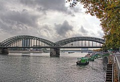 Rhine River with Hohenzollern Bridge in Cologne, Germany (PhotosToArtByMike) Tags: hohenzollernbridge rhineriver colognegermany cologne germany dom koln klnerdom rail railway oldtown oldquarterofcologne europe bridge steelarchbridge