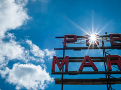 Sunstar through the Pike Place Market sign (Paul T. Marsh/PositivePaul) Tags: paulmarshphotography paultmarsh leicad3 lightroom5 sky wwwpaulmphotographycom pikeplacemarket color 25mmf14 sunstar leica pacificnorthwest leicadigilux3 seattle 2016