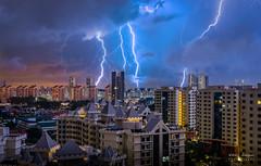 Insomnia (NikolajAlexanderPics) Tags: city longexposure light sky urban storm rain clouds singapore cityscape colours flash thunderstorm tropics