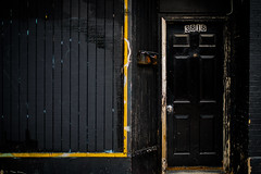 (217/366) Black with Yellow and Rust (CarusoPhoto) Tags: chicago john caruso carusophoto pentax ks2 city urban banal mundane everyday ordinary black yellow rust door mailbox windown wall wood brick photo day project 365 366 smc pentaxda 35mm f24 al smcpentaxda35mmf24al prime light
