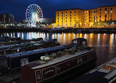 Hermione, Salthouse Dock (.annajane) Tags: salthousedock water dock reflection night liverpool uk england merseyside canalboat wheel pride albertdock hermione narrowboat boat flowers liverpoolpride