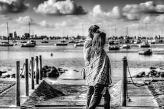 Couple (koaysusan) Tags: bw depthoffield light cloudscape harbour couple boats seascape blackandwhite monochrome outdoor