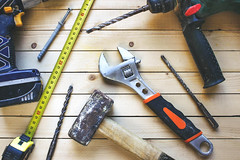 Different working tools (ikrents) Tags: tool business wood home contractor house work improvement construction material occupation building industry restoring housing steel tablet repairing repairman old designer digital engineer worker screwdriver shaking plank equipment desk toolbox architecture design surveyor group blueprint color carpenter pliers spanner paintbrush agreement professional ownership architect hammer ruler tape backgrounds