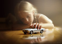 Child's Play (Sonya Adcock Photography) Tags: child kid childphotography childhood play playtime playschool car modelcar model silver firebird wheels transportation light windowlight girl glow gold fineart fineartphotography sonyaadcock sonyaadcockphotography nikon nikkor nikkor105mmdc