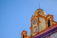 Town Hall Clock of Almeria (zuissell) Tags: espaa building clock architecture facade square andaluca spain mural europe coatofarms sunny nobody nopeople cover dome townhall restoration andalusia almeria almera plazavieja architecturalelement plazadelaconstitucion