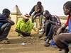 a game of tiddas (Mark Panszky) Tags: playing game men sticks stones westafrica mali touareg mopti tiddas