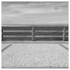 fence - tretat // iphone 5 (tofurocker) Tags: iphone tretat normandy normandie sw bw blackandwhite square promenade shore