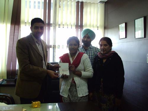 Navneet Kaur receiving Canada study visa from director