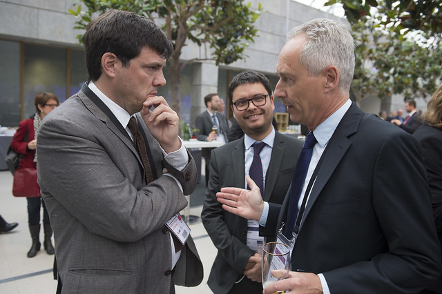 Andrés Gómez-Lobo, Alexis Michea and Stephen Perkins attending the reception