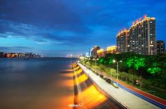 Hangzhou Bing Jiang - Illuminated Riverside (Andy Brandl (PhotonMix.com)) Tags: china sky river nikon skyscrapers shore hangzhou leds bluehour modernarchitecture highrises zhejiang g20 qiantangjiang newdevelopments photonmix joggingandcyclinglanes