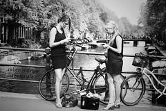 Lost in translation (Mister Blur) Tags: amsterdam girls bridge jordaan lostintranslation mobile phones blackandwhite blancoynegro nikon d7100 50mm
