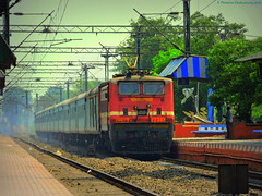 Indian Railways : Devil looking WAP 4 thunders through rural SER with Howrah bound Shatabdi Express ! (Clicker Purnava) Tags: road railroad sky india beautiful beauty sport electric speed train ir amazing cool track day afternoon cloudy indian awesome extreme ngc transport cruising rail overcast loco wb rails locomotive express passenger ser sel incredible railways bengal railfan trainspotting src puri outstanding lhb iri luxurious westbengal howrah mps indianrailways shatabdiexpress natgeo railfanning indiatravel irfca railfans 12278 incredibleindia trainwatchers clw consist hwh shatabdi southeasternrailway ecor wap4 indialove santragachi railbuff eastcoastrailway sankrail ferroequinologist worldtrains discoveryindia marvelshots trainsworldwide railwaylovers