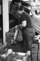 Woman Buying Tomatos (Amens Alteraporta) Tags: woman tomato buying important choose wise wisely streetphotography street freelensing free lens tilt shift