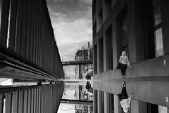 Zrich Giesshbel (maekke) Tags: zrich giesshbel puddlegram reflection woman man bw noiretblanc streetphotography urban architecture pov pointofview switzerland ch 2016 fujifilm x100t szu trainstation